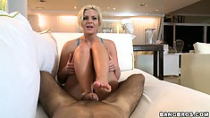Busty blonde Phoenix Marie uses her feet and hands and he uses his