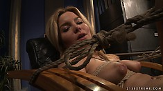 She gets fingered and then spread wide on the floor and sucks dildo