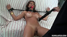 Monique Fuentes gets tied and gagged, spread wide and pussy pumped