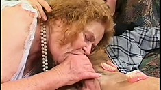 Fat old granny gets a young piece of meat caught in her throat and pussy