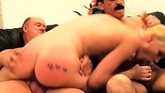Slender college girl spreads her legs to let in two older guys' dicks