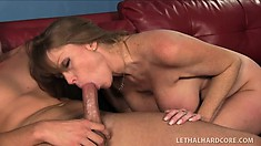 Hot looking busty Milf Darla Crane sucks and titty fucks herself out of a ticket