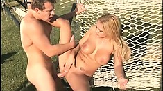 Sultry blonde with big round boobs Trina Michaels fucks a big cock in the outdoors