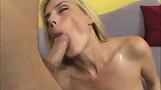 Horny blonde cougar with big juicy curves gets shagged on the couch
