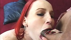 Wild redheaded babe shows off her tattoo while getting her ass reamed