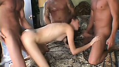 Barely legal brunette bitch finally gets a trio of delicious dicks to devour