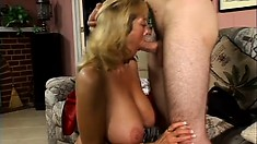 Horny MILF whips out her massive melons to get a young stud hard