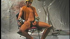 Black stud caresses his ripped body and jerks his long prick to orgasm