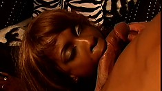 Ebony whore gets down to service a stranger's hard and bare cock